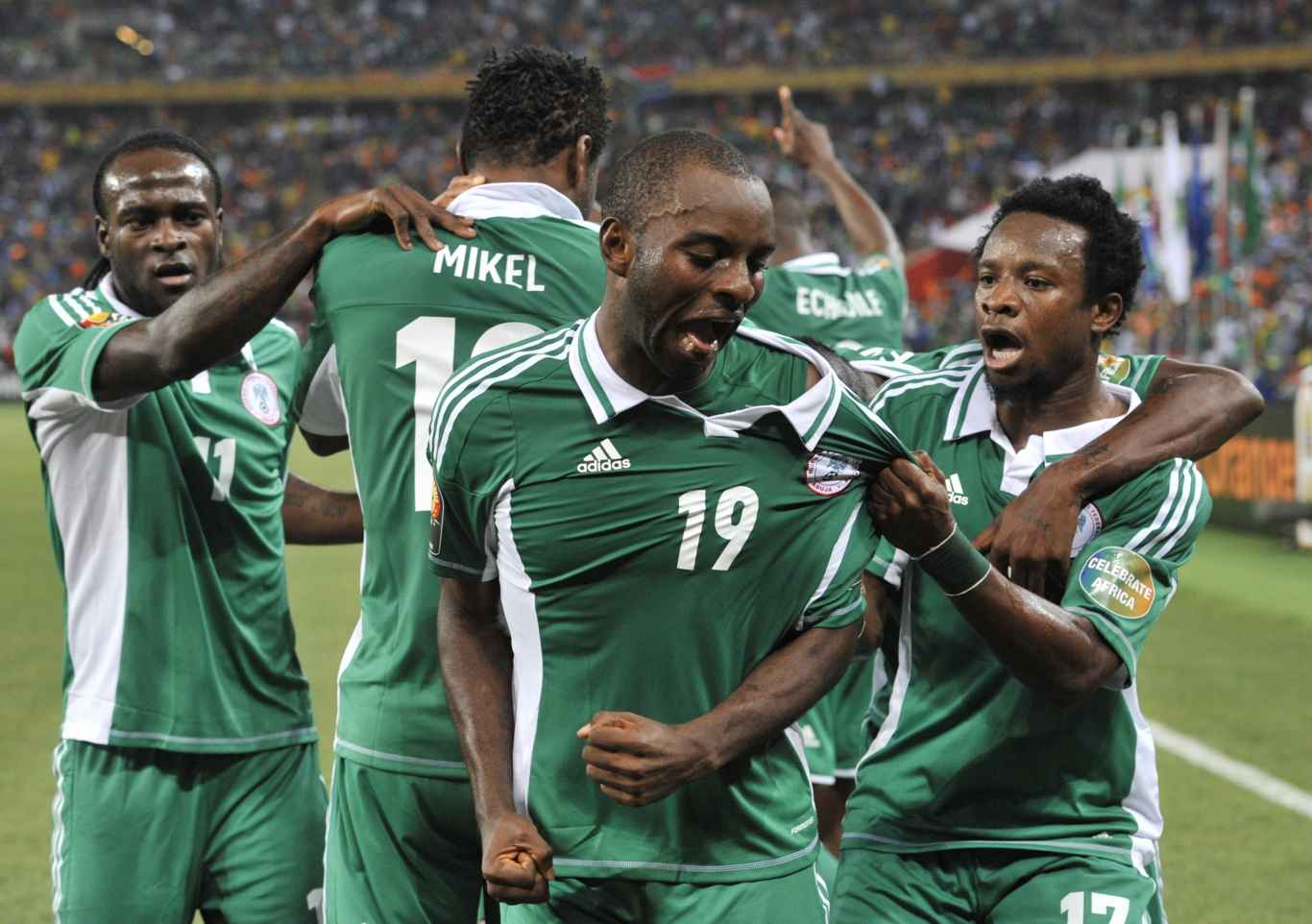 Nigeria's forward Sunday Mba (C) celebrates with teammates after scoring the opening goal against Burkina Faso during the 2013 African Cup of Nations final football match between Burkina Faso and Nigeria on February 10, 2013 at Soccer City stadium in Johannesburg.
